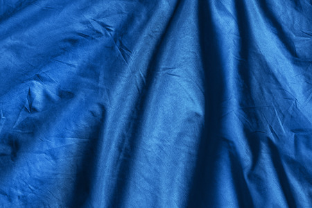 draped cloth: Blue draped cloth as a background