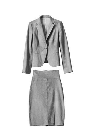 白で隔離された女性のグレーのフォーマル スカート スーツ 写真素材