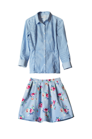 Set of blue mini skirt and blouse isolated over white photo