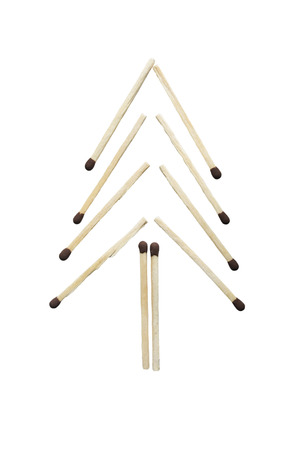 Group of safety matches in the shape of fir-tree on white background photo