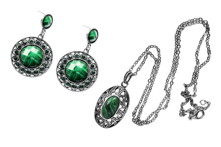 Set of vintage malachite pendant and earrings on white background photo