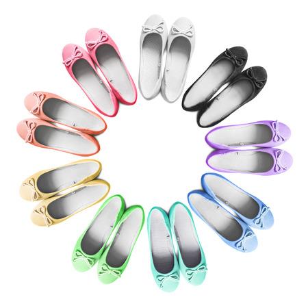 Set of multicolor textile girlish flat shoes on white background Stock Photo