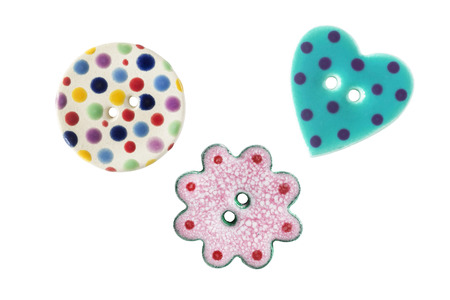 colorfu: Group of three colorfu funnyl buttons on white background Stock Photo