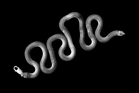 braided flexible: Conceptual silver chain isolated over black Stock Photo