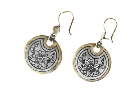 gilded: Old ethnic blackened silver and gilded earrings on white background Stock Photo