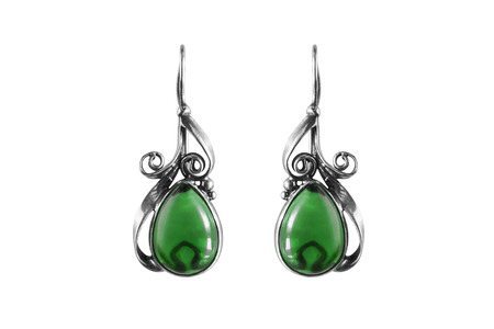 Silver vintage emerald earrings on white background photo