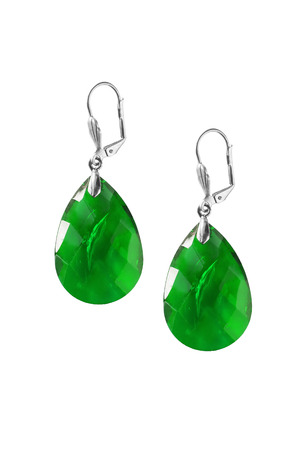 Green emerald earrings isolated over white photo