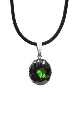 green gemstone: Dark green faceted gemstone on black cord isolated over white