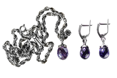 Set of amethyst pendant and earrings  isolated over white photo