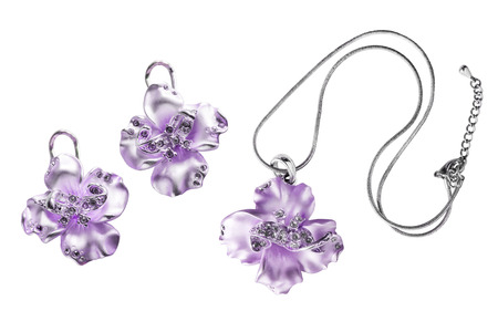 Set of pendant and earrings isolated over white photo