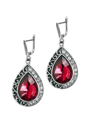 Vintage silver ruby earrings isolated over white photo