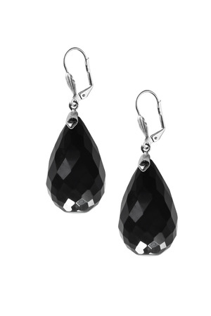 black onyx: Black onyx faceted earrings isolated over white