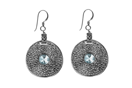 topaz: Silver ethnic earrings with blue topaz isolated over white