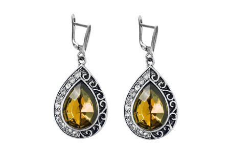 Silver earrings with yellow gemstones and crystals isolated over white photo