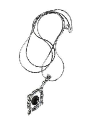 black onyx: Silver vintage pendant with black onyx on white background