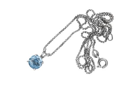 topaz: Blue topaz pendant on silver chain isolated over white Stock Photo