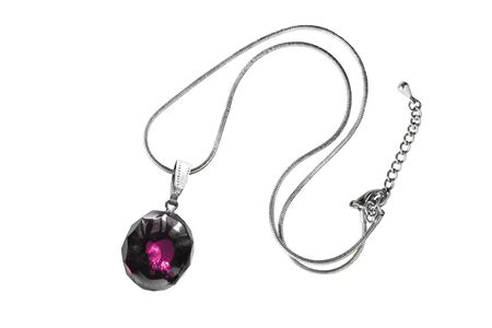 Pink gemstone pendant on a chain isolated over white photo