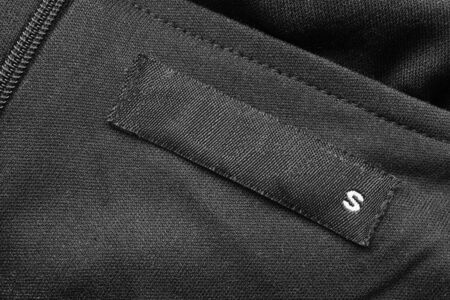 Black label on black cloth as a background photo