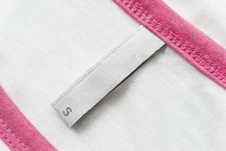 White blank label on cloth as a background photo
