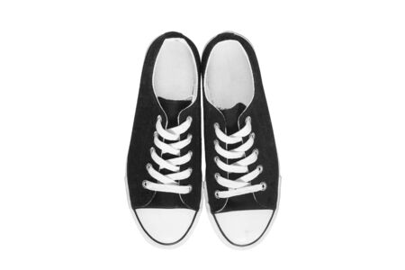 lacing sneakers: Black classic gumshoes on white background Stock Photo