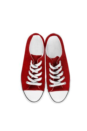 lacing sneakers: Red traditional gumshoes isolated over white