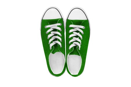 lacing sneakers: Green gumshoes isolated over white