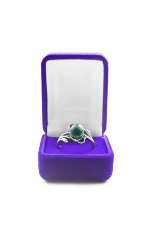 malachite: Silver malachite ring in purple box isolated over white Stock Photo