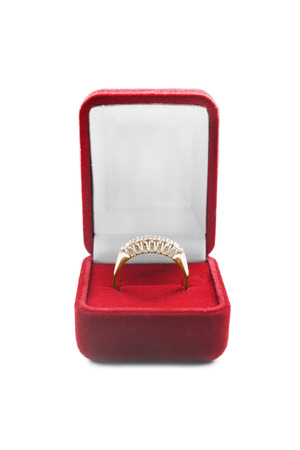 Golden ring in opened box on white background photo