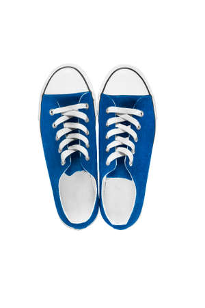 lacing sneakers: Blue classic gumshoes on white background Stock Photo