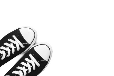 lacing sneakers: Black sneakers on white as a background