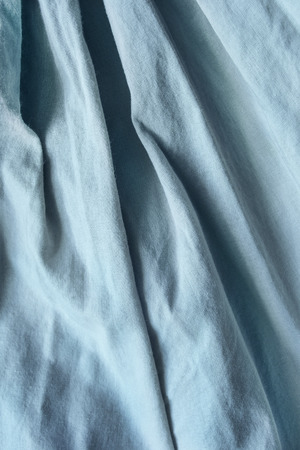 draped cloth: Draped blue linen as a background