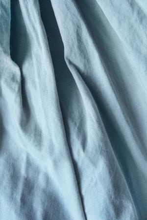 draped: Draped blue linen as a background