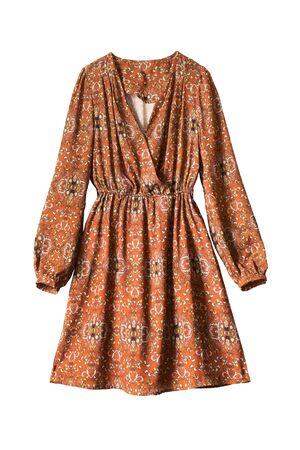 terracotta: Ornamental terracotta silk dress on white background Stock Photo