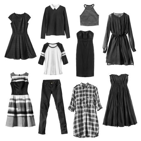 白で分離された黒の女性服のグループ