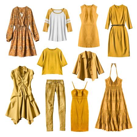 白い背景の上の黄色の女性服を設定します。