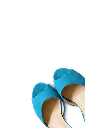 walk in closet: Pair of blue shoes isolated over white Stock Photo