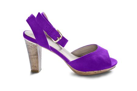 walk in closet: Purple suede high heeled shoe on white background