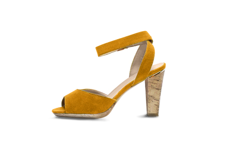 heel strap: Yellow suede high heeded shoe on white background