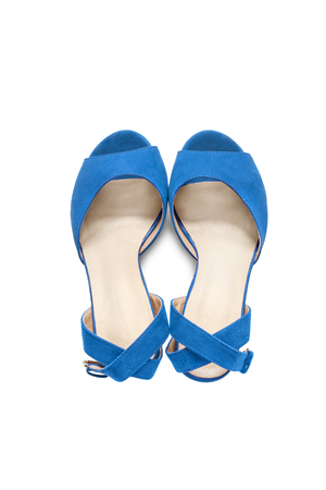 walk in closet: Blue suede shoes with straps isolated over white