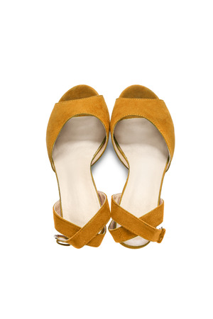 walk in closet: Yellow textile shoes with straps on white background Stock Photo