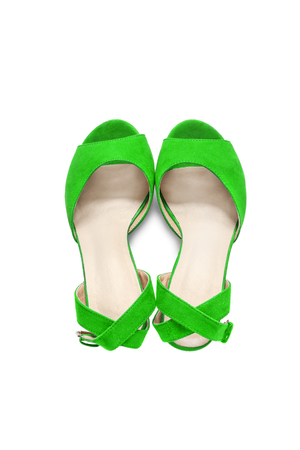 walk in closet: Green suede shoes with straps on white background