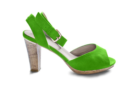 walk in closet: Green suede high heeled shoe on white background