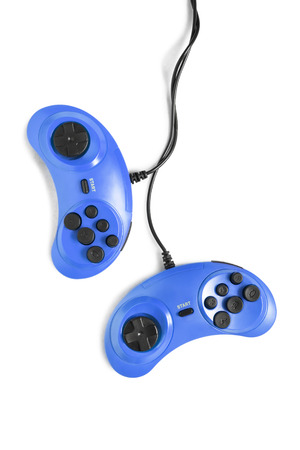 Two wired gamepads isolated over white Stock Photo