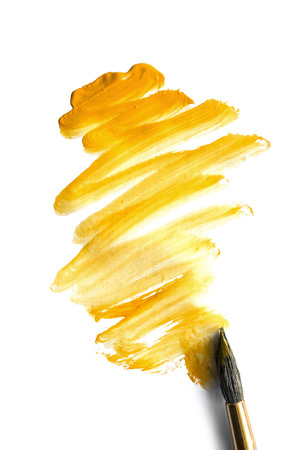 yellow paint: Yellow paint and a brush on white background Stock Photo
