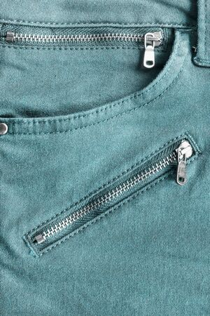 cotton  jeans: Blue jeans pocket with zippers as a background Stock Photo
