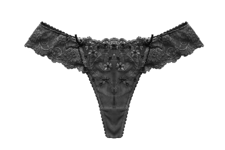 thong panties: Black lacy thong panties isolated over white