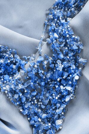 draped: Blue beads on draped silk as a background