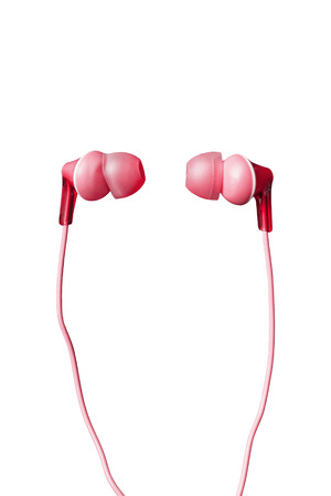 handsfree telephones: Pink wired earphones isolated over white