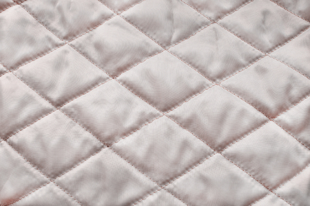 quilted: Quilted blush satin texture as a background Stock Photo