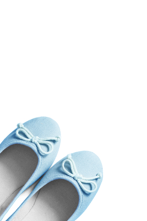 flat shoes: Pair of blue textile flat shoes isolated over white Stock Photo